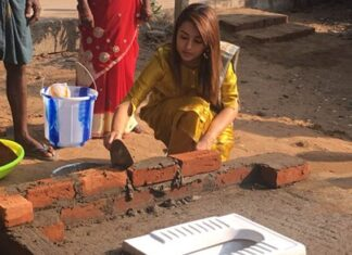 Actress Trisha Cementing Bricks For A Toilet