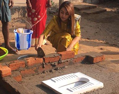 Actress Trisha Cementing Bricks For A Toilet