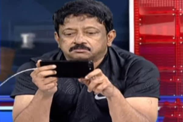 Ram Gopal Varma Caught Watching PORN Live In TV Studio