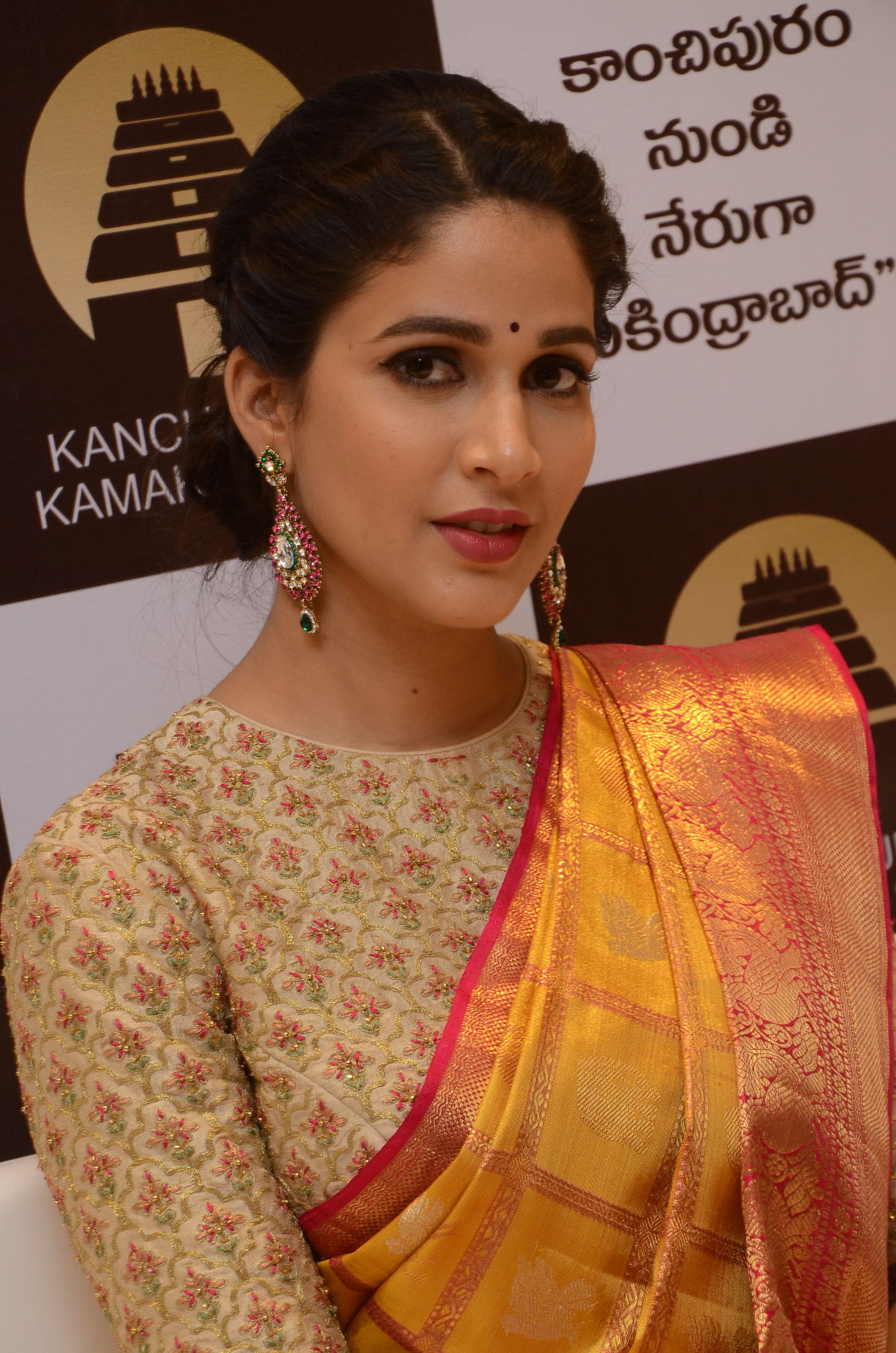 lavanya tripathi saree stills at kancheepuram kamakshi silks launch 15