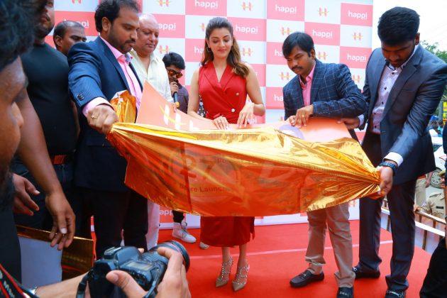 kajal aggarwal red dress photos at happi mobiles launch at hanumakonda 11