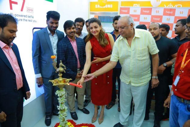 kajal aggarwal red dress photos at happi mobiles launch at hanumakonda 6
