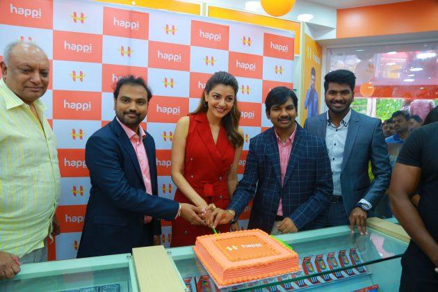 kajal aggarwal red dress photos at happi mobiles launch at hanumakonda 9