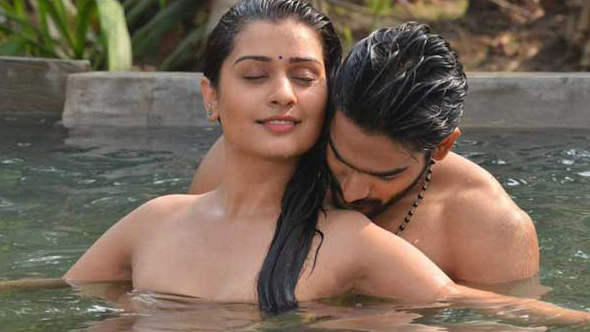 rx100 movie actress payal rajput and karthikeya liplock stills southcolors 3